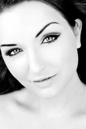 A beautiful young woman looking at the camera. Black and white. photo