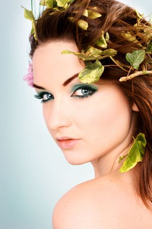pretty eyes: A beautiful young woman with flowers in her hair. Stock Photo
