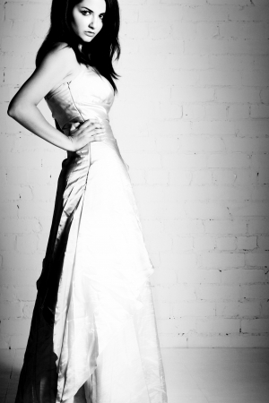 prom dress: A black and white portrait of a pretty young woman in a wedding dress.