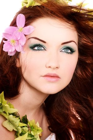 A beautiful young woman with flowers in her hair. photo