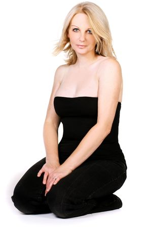 An attractive middle aged woman wearing black in a white studio.