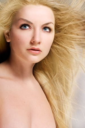 A young woman with her blond hair blowing in the wind. photo