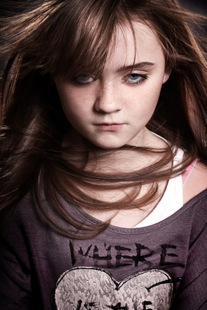 A beautiful young girl looking at the camera with wind in her hair. Stock Photo - 8583596