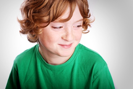 curly hair child: A cute young boy looking to the camera on a white background.