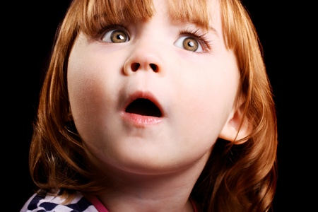 An adorable little girl who is shocked beyond belief! photo