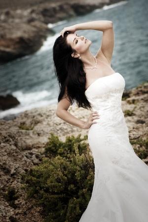 adult mermaid: Beautiful bride on the coast