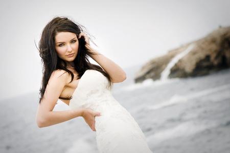 A beautiful bride on the coast photo