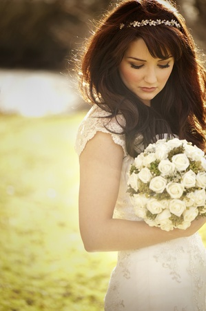 Vintage bride outdoors with bouquet Stock Photo