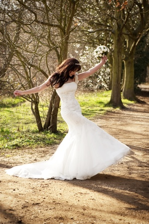 adult mermaid: A joyous bride on a wooded path outside