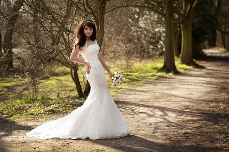 adult mermaid: Beautiful bride outdoors in a forest