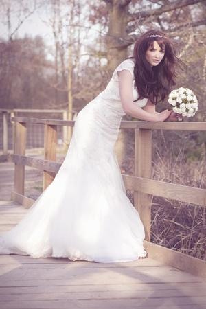 adult mermaid: A beautiful bride looking at the camera outdoors