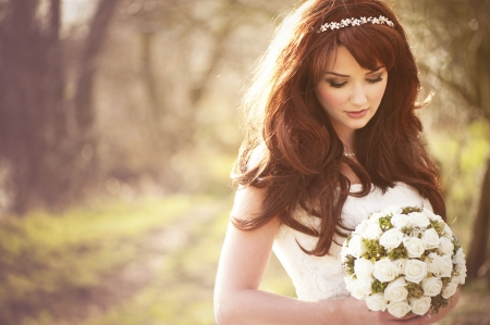 Beautiful bride outdoors in a forest  photo