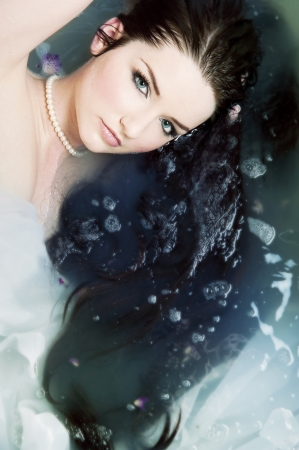A beautiful brunette submerged in water photo