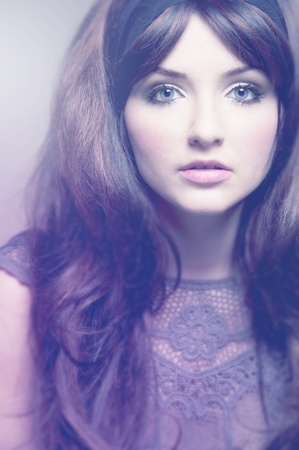 attractive gorgeous: A soft vintage portrait of a brunette in 60s style fashion. Stock Photo