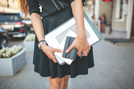 Beautiful Business Girl in the City with Documents Stockfoto