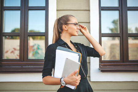 Beautiful Business Girl in the City with Documents Standard-Bild