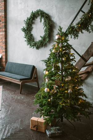 Beautiful holiday decorated loft with Christmas tree with present boxes under it