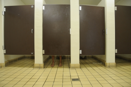 feet showing underneath stall in public restroom Stock Photo - 5167523