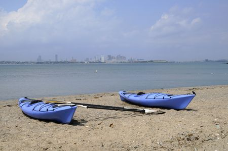 Two Blue kayaks along shore of Spectacle Island, in the\ Boston Harbor Islands