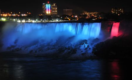 Niagara Falls lit up at night photo