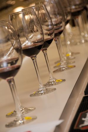 row of several wine glasses with red wine Stock Photo