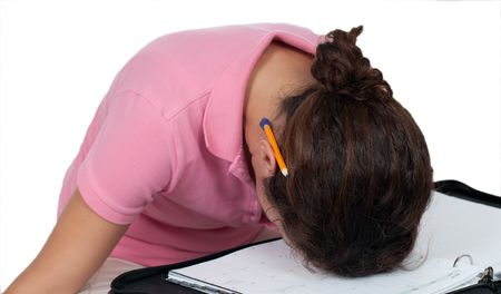upset woman with head resting on planner photo