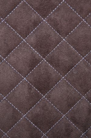 suede: Brown suede leather with white criss cross stitching pattern Stock Photo