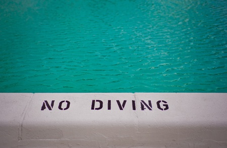 no diving sign: No diving sign against blue swimming pool Stock Photo