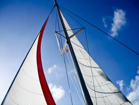 Set sails against a beautiful blue sky Stock Photo - 12687902