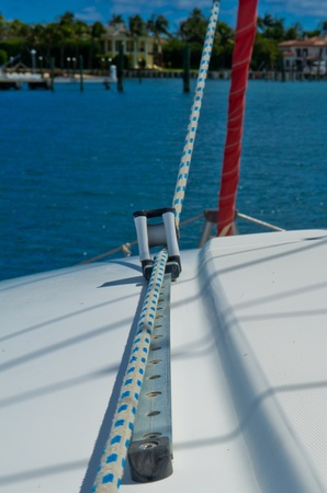 White and blue rope running through track and pulley on a sailboat Stock Photo - 12688363