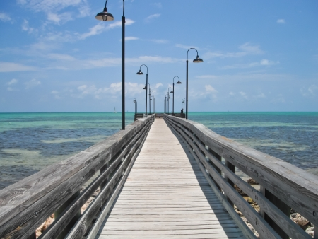 wooden pier and boardwalk over ocean in the Florida Keys photo