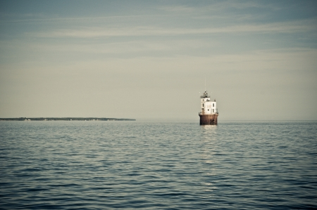 Horizontal photo of a lighthouse that sits in the water in the Chesapeake Bay.  The Smith Point Lighthouse