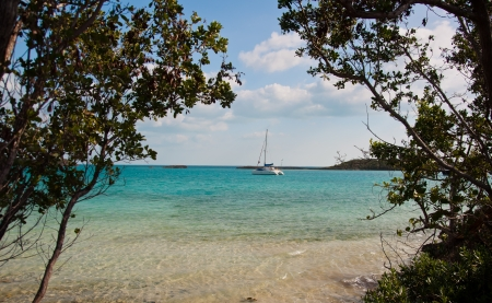 Catamaran sailboat anchored in beautiful turquoise waters in the islands of the bahamas.  copy space available photo