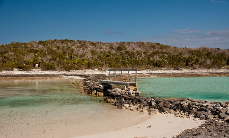 Tropical lagoon with small wooden bridge to cross over the turquoise waters of the bahamas
