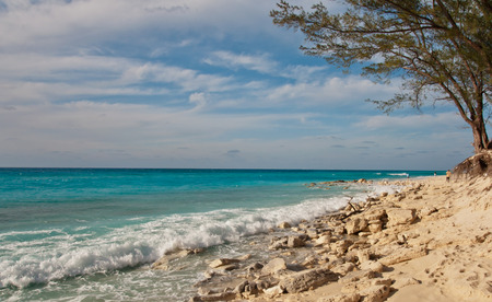 View of the ocean from alicetown, bimini, bahamas.  small rocks along shore with waves rolling in.  copy space available. Stock Photo - 37396073