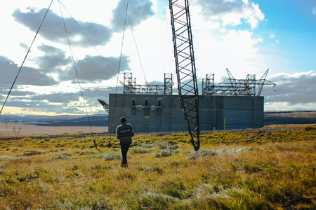 electric station: Electric station and tower, a man among Icelandic nature