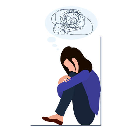 A woman is depressed with confused thoughts in her head. Mental disorder, search for answers, confusion concept. A young sad girl sits in the corner and hugs her knees unhappily.