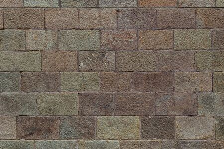 Brick wall texture. Old brickwork with multicolor bricks in tints of pink, yellow, green. Close shot. Stock fotó - 138385278