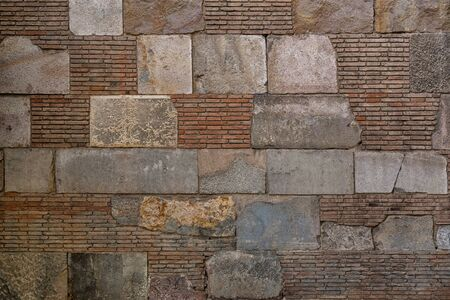 Old brick wall background. Ancient brickwork combined with big stone blocks. The photo was taken in Old town of Barcelona, Spain. Stock fotó - 138385381
