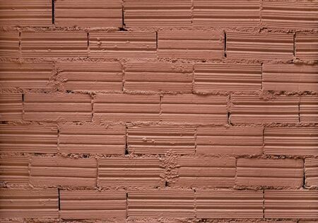 Brick wall background. Decorative bricks with interesting texture and cement joints are covered with coral paint. Close shot. Stock fotó - 138385231