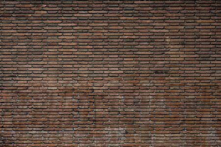 Red brick wall background. Old dirty brick wall with stains. 스톡 콘텐츠