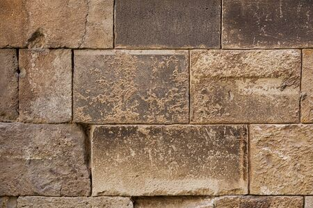 Ancient brick wall background. Big rectangle stone blocks with beautiful texture. Close shot.