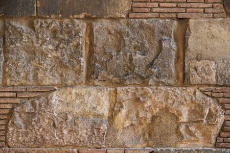 Old brick wall background. Ancient brickwork combined with big stone blocks. Close shot. The photo was taken in Old town of Barcelona, Spain. Stock fotó - 138385623