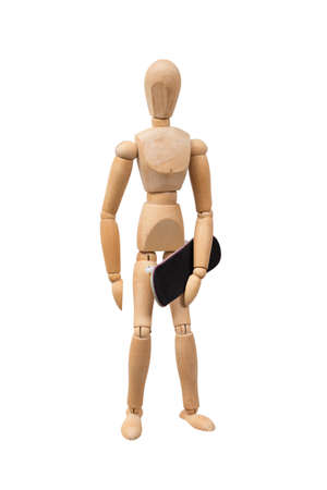 Wooden mannikin standing and holding fingerboard (mini skateboard). Concept of skateboarding culture. Isolated on white background. Front view.