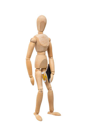 Wooden mannikin standing and holding fingerboard (mini skateboard). Concept of skateboarding culture. Isolated on white background. Half-turn view.