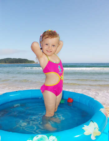 The girl swims in pool on the sea                                photo