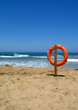 kreta: Life bouy in the empty beach of Crete, Greece