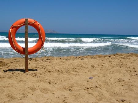 Life bouy in the empty beach of Crete, Greece Stock Photo - 1537316