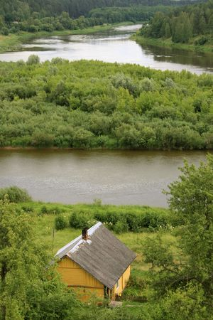homestead: Old homestead by the river in Lithuania  Stock Photo