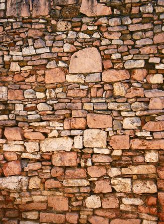 desertion: Old brick wall background in medieval italian town Assisi